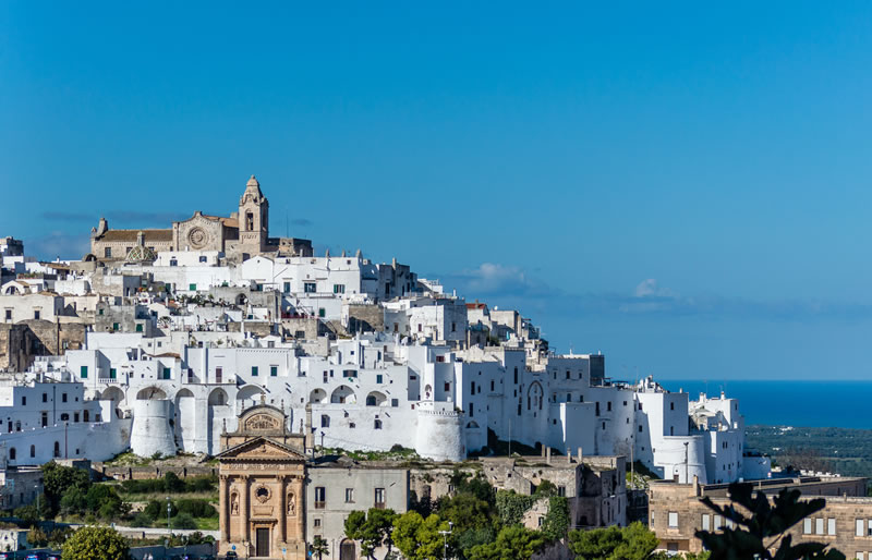"<b>Ostuni</b><br> <br> The well-known ""white city"" offers an outlandish scenario graced with  lime-painted buildings creating a particular light effect, especially in Summer.  The medieval village enjoys a stunning and scenic view from the hills."